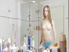 Ultra skinny schoolmate in the shower