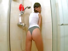 Wet ass toying in the charming shower