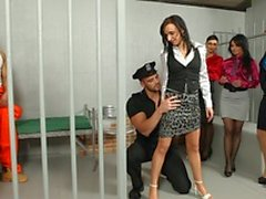 Horny prison guard gets his cock sucked by male prisoners then a group of babes join them