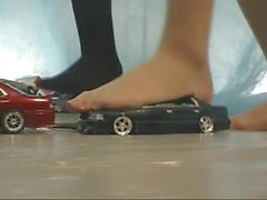 Nylon feet crushing toy cars and train