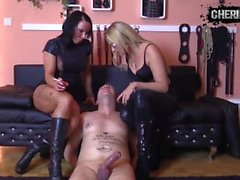 two mistresses smoking and torturing slave