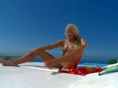 Leggy blonde Megana masuarab tying by the pool