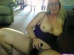 Big tit mom dildos her pussy in living room