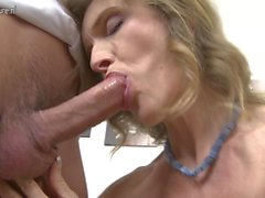 Busty granny fucking and sucking her toy boy