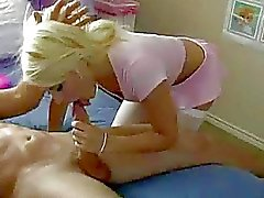 Sexy blonde does a 69 on soft bed with guy