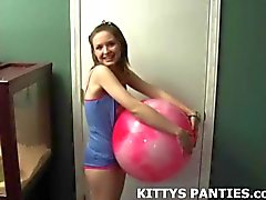 Cute teen Kitty teasing in a tube top and shorts