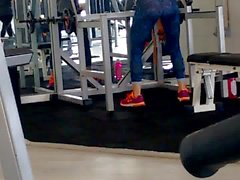 Hot blonde squat with thong at gym
