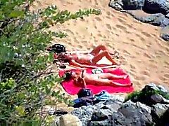Nude girls on beach sunning.