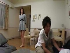 Lustful Japanese mom has a younger guy satisfying her sexual desires