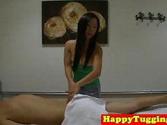 Skinny asian masseuse wanks clients dick