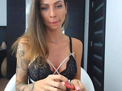 Brunette does a solo masturbation for her girlfriend