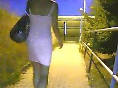 Blonde bangs outdoor in public at night