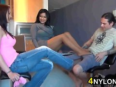 Threesome Foot Job With Their Nylons On