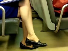 Mature woman legs on train