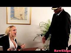 Busty blonde slut rides black cock in office