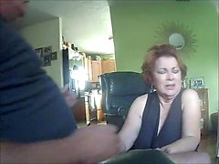 Redhead gives blowjob on webcam