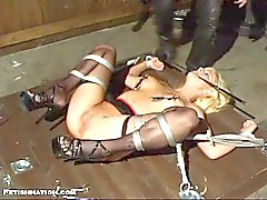 Blonde gets strapped up and pussy prodded