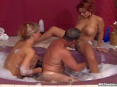 curvy blonde and redhead milfs share meaty cock in bathtub
