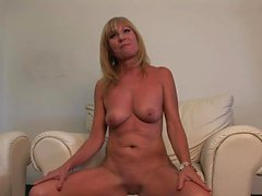 Mature cougar plays with her pussy