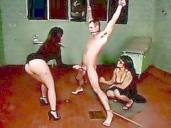 Two dominas and one male for them to have their fun with