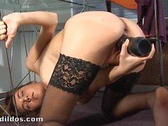 Amateur brunette in stockings loves big dildo