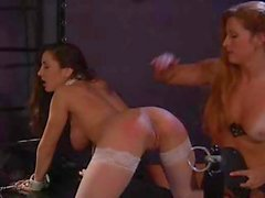 Two babes in the dungeon being shown how to dominate the other
