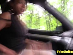 Ebony brit blowing officers cock in the car