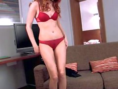 Sweet redhead Kami takes of fher red lingerie