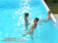 Three chicks sucking my cock in a pool