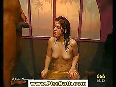 Golden shower fetish slut is drenched in piss