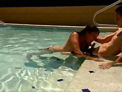 She sucks her BF's shaft in the pool