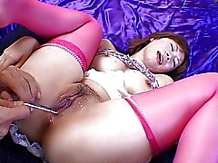 Pink stocking Asian chick has toy treatment