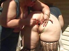Two chubby southern lesbians do some dildo fucking on the porch