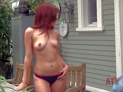 Teen redhead Lizzie Tucker gets nude in backstage video