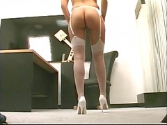 Cute brunette with small tits toys her pussy in the office