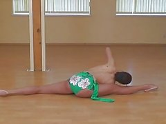Sexy and flexible teen gymnastic stretching naked on floor