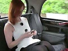 Redhead flashing pussy in a British fake taxi