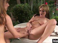 Pretty lesbians enjoy masturbating together outdoors
