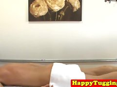 Asian masseuse jerking while getting fingered