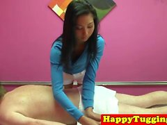 Skinny asian masseuse jerking and cockriding