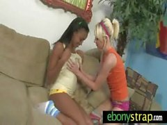 Strap-on dildo lesbians interracial fuck 1