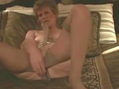 Old Classy Slut fucks herself with Pantyhose