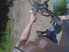 Riding and strolling naked in public nature in daylight POV
