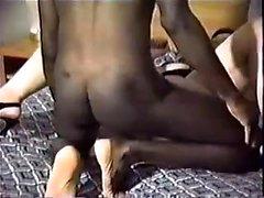Brunette milf with big ass giving blowjob