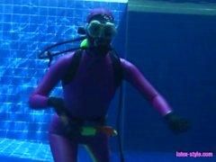 Underwater adventure of latex diver