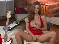 Busty Sabrina Maree plays with her pussy after playing guitar