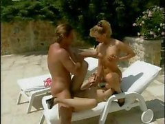 By the pool a German lezzie becomes a nasty threesome with dick
