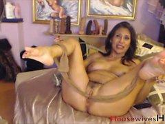 Old kinky MILF stuffing pantyhose into vagina
