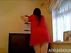 upskirt putting up a shelf by adelesexyuk