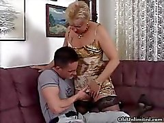 Horny blonde granny in stockings sucking part1